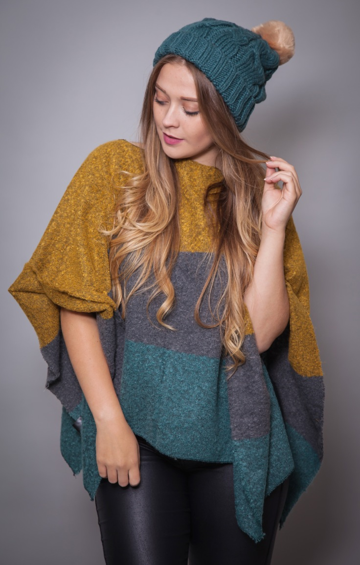 Powder Pom Pom Beanie Hat coupled with the Powder Tess Poncho, both available on Colmers Hill Fashion